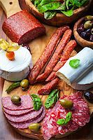Antipasto catering platter with different meat and cheese products Stock Photo - Royalty-Freenull, Code: 400-06694632