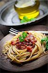 Italian food. Pasta spaghtti with tomato sauce, olives and garnish Stock Photo - Royalty-Free, Artist: mythja                        , Code: 400-06696322