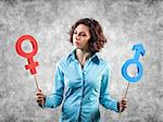 Two symbols of a different gender in hands of the girl Stock Photo - Royalty-Free, Artist: FotoVika                      , Code: 400-06698859