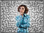 Photo of the girl before a difficult labyrinth Stock Photo - Royalty-Free, Artist: FotoVika                      , Code: 400-06699165