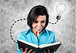 Happy girl with the big book in hands Stock Photo - Royalty-Free, Artist: FotoVika                      , Code: 400-06699404
