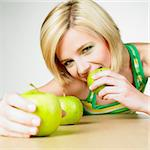woman with apples Stock Photo - Royalty-Free, Artist: phbcz                         , Code: 400-06699645
