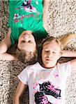 Young Girls Lying Down on a Carpet in Studio Stock Photo - Premium Royalty-Free, Artist: Uwe Umstätter, Code: 600-06701799