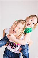 Portrait of Girls Having Fun in Studio Stock Photo - Premium Royalty-Freenull, Code: 600-06701800