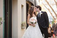 Portrait of Bride and Groom Kissing, Toronto, Ontario, Canada Stock Photo - Premium Royalty-Freenull, Code: 600-06701867