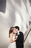 Portrait of Bride and Groom Kissing, Toronto, Ontario, Canada Stock Photo - Premium Royalty-Freenull, Code: 600-06701870