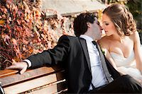 Portrait of Bride and Groom Kissing on Bench in Autumn, Toronto, Ontario, Canada Stock Photo - Premium Royalty-Freenull, Code: 600-06701878