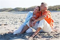 Mature Couple Sitting on Beach, Jupiter, Palm Beach County, Florida, USA Stock Photo - Premium Royalty-Freenull, Code: 600-06701932