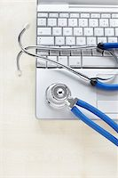 Still Life of Laptop and Stethoscope Stock Photo - Premium Rights-Managednull, Code: 700-06701940