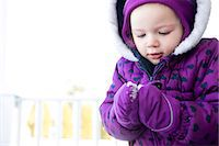 Girl Making Snowball Stock Photo - Premium Rights-Managednull, Code: 822-06702167