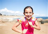 Portrait of Smiling Girl on Beach Stock Photo - Premium Rights-Managednull, Code: 822-06702174