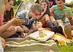 Teenage Boy Blowing out Birthday Candles Stock Photo - Premium Rights-Managed, Artist: ableimages, Code: 822-06702216