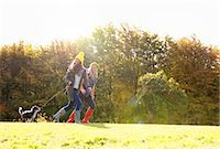 Mother and Daughter Running in Park with Dog Stock Photo - Premium Rights-Managednull, Code: 822-06702232