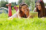 Teenage Girls Lying on Grass Using Tablet Stock Photo - Premium Rights-Managed, Artist: ableimages, Code: 822-06702239
