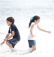 Boy and Girl Playing in Sea Water Stock Photo - Premium Rights-Managednull, Code: 822-06702251