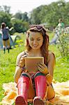 Teenage Girl Using Tablet Outdoors Stock Photo - Premium Rights-Managed, Artist: ableimages, Code: 822-06702257