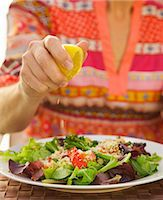 Woman's Hand Squeezing Lemon on Couscous Salad Stock Photo - Premium Rights-Managednull, Code: 822-06702259
