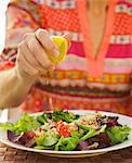 Woman's Hand Squeezing Lemon on Couscous Salad Stock Photo - Premium Rights-Managed, Artist: ableimages, Code: 822-06702259