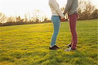 Young Couple Holding Hands in Field, Low Section Stock Photo - Premium Rights-Managednull, Code: 822-06702298