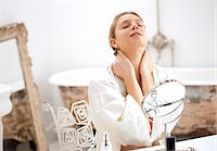 Woman at Dressing Table Rubbing her Neck Stock Photo - Premium Rights-Managednull, Code: 822-06702302