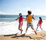 Back View of Children Running into the Sea Stock Photo - Premium Rights-Managed, Artist: ableimages, Code: 822-06702306