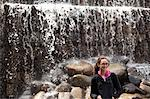 Woman Standing in front of Shinjuku Chuo Park Waterfall, Tokyo, Japan Stock Photo - Premium Rights-Managed, Artist: ableimages, Code: 822-06702348