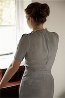 Back View of Woman Looking Out of Window Stock Photo - Premium Rights-Managednull, Code: 822-06702354