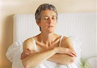 Woman Sitting in Bed with Arms Crossed Stock Photo - Premium Rights-Managednull, Code: 822-06702379