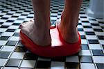 Close up of Feet on Weighing Scale Stock Photo - Premium Rights-Managed, Artist: ableimages, Code: 822-06702398