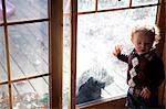 Young Boy Standing by Dirty Window Stock Photo - Premium Rights-Managed, Artist: ableimages, Code: 822-06702424