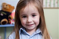 Portrait of Young Girl Smiling Stock Photo - Premium Rights-Managednull, Code: 822-06702425