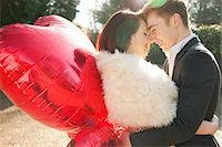 Young Couple Embracing Holding Heart Shaped Balloons Stock Photo - Premium Rights-Managednull, Code: 822-06702443