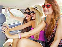 people and vacation - Teenage Girls Taking Self Portrait Photo Inside Car Stock Photo - Premium Rights-Managednull, Code: 822-06702455