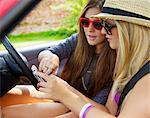 Teenage Girls Using Cell Phone Inside Car Stock Photo - Premium Rights-Managed, Artist: ableimages, Code: 822-06702473
