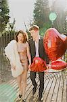 Young Couple in Park Holding Heart Shaped Balloons Stock Photo - Premium Rights-Managed, Artist: ableimages, Code: 822-06702475