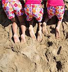 Back View of Girls in Matching Outfit Kneeling on Sand, Cropped Stock Photo - Premium Rights-Managed, Artist: ableimages, Code: 822-06702491