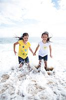 families playing on the beach - Twin Girls Playing in Sea Water Stock Photo - Premium Rights-Managednull, Code: 822-06702519