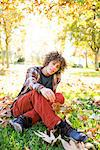 Young Man Sitting in Park in Autumn Stock Photo - Premium Rights-Managed, Artist: ableimages, Code: 822-06702535