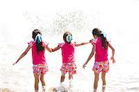 families playing on the beach - Back View of Girls in Matching Outfit Walking into the Sea Stock Photo - Premium Rights-Managednull, Code: 822-06702559