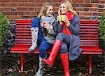 Mother and Daughter Sitting on Red Bench with Hot Drinks Stock Photo - Premium Rights-Managed, Artist: ableimages, Code: 822-06702574