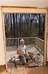 Hispanic carpenter preparing doorway for new frame to side of house Stock Photo - Premium Royalty-Freenull, Code: 6105-06702958