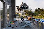 Adirondack chairs and bathing clothes on the porch of a summer beach house, Block Island, Rhode Island, USA Stock Photo - Premium Royalty-Free, Artist: SEED9, Code: 6105-06703017