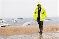 Public works engineer carrying water sample packet from lake, Portland, Maine, USA Stock Photo - Premium Royalty-Freenull, Code: 6105-06703098