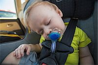 Baby boy sleeping on a car seat with pacifier, Block Island, Rhode Island, USA Stock Photo - Premium Royalty-Freenull, Code: 6105-06703147