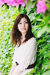 Japanese woman surrounded by green leaves looking at camera Stock Photo - Premium Rights-Managed, Artist: Aflo Relax, Code: 859-06710923