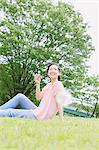 Japanese woman relaxing in a meadow Stock Photo - Premium Rights-Managed, Artist: Aflo Relax, Code: 859-06710929