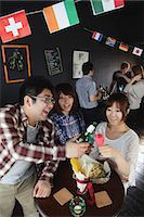 Young people having a drink in a bar Stock Photo - Premium Rights-Managednull, Code: 859-06711147