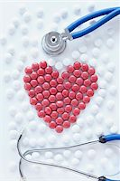 close-up of red pills arranged into heart shape with stethoscope Stock Photo - Premium Rights-Managednull, Code: 700-06714048