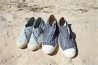 Two pairs of blue sneaker shoes on sand at the beach Stock Photo - Premium Rights-Managednull, Code: 700-06714055