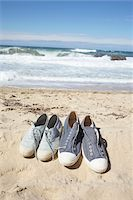 Two Pairs of Blue Sneaker Shoes at the Beach Stock Photo - Premium Rights-Managednull, Code: 700-06714056